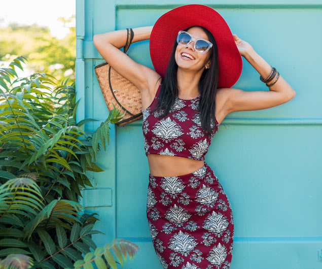 Woman Wears Fashion Forward Name Designer Red Hat Naples Florida | Platinum Dry Cleaners